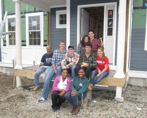 The group of volunteers from Crimson Key Society, as well as volunteers from Habitat for Humanity.