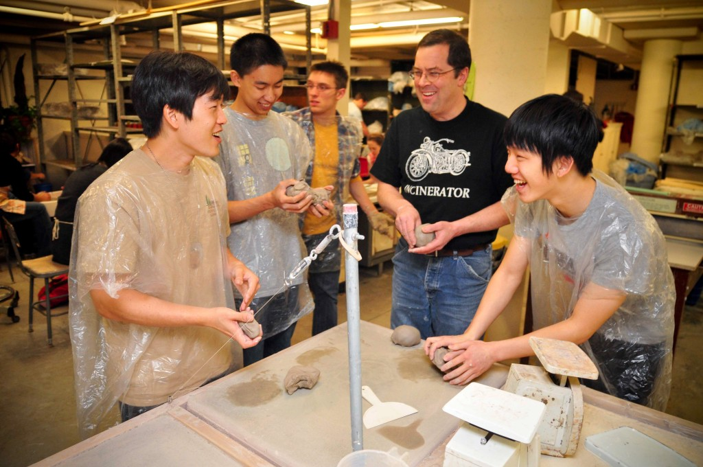 "Students work on a project at the OFA ceramics studio during the annual fall ""Clay All Night"" event."