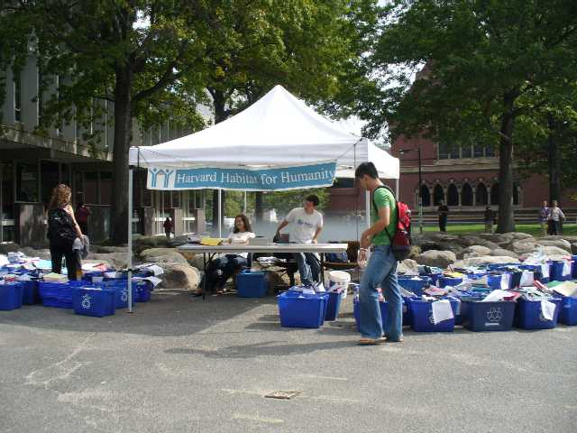 Habitat for Humanity book sale in front of the Tanner Fountain by the Science Center. Memorial Hall appears in the background