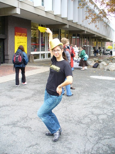 Golden Hat Girl promoting Harvard's production of