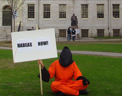 A member of the Harvard Anti-Torture Coalition demands