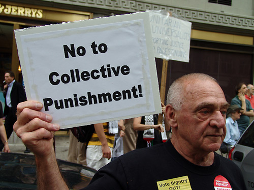 Demonstrator at the Israeli Consulate Boston saying no to collective punishment.