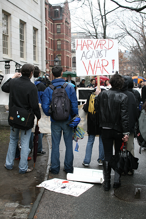 Harvard gathers against the War at the Statue of the Three Lies.