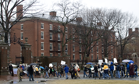 Harvard Anti-War Coalition passing Holworthy Hall on the way to the Statue of the Three Lies.