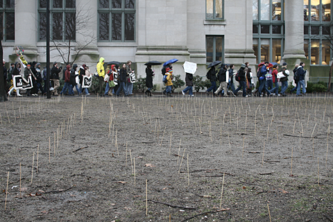 Harvard Anti War Coalition marches past skewers planted in the Law School Yard to commemorate iraqi and American dead.