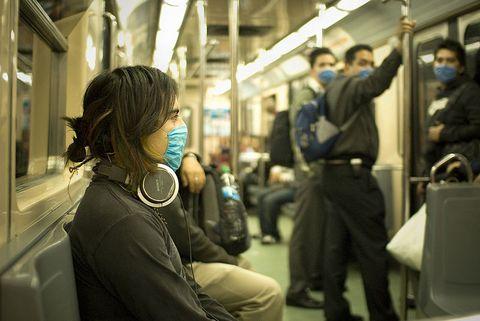 Swine flu masked train passengers in Mexico City -April 2009