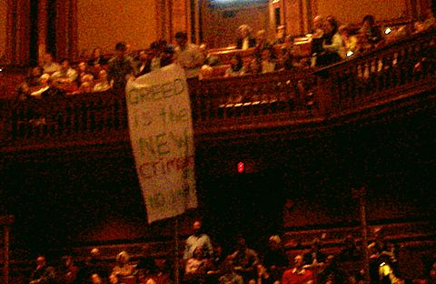 Students Labor Action Movement drop 'Greed is the New Crimson' Banner.