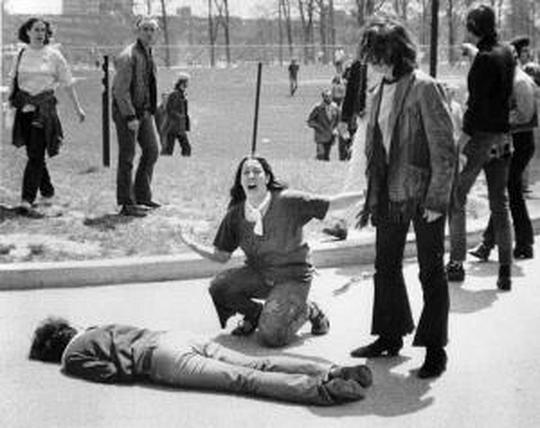 """Mary Ann Vecchio kneeling over the body of Jeffrey Miller"""