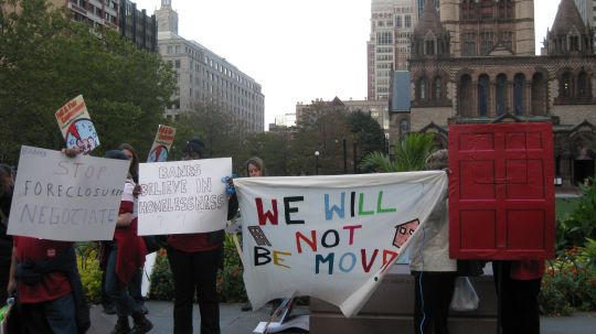 """Demonstrators with sign """"We Will Not Be Moved""""."""