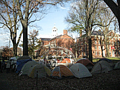 Occupy Harvard encampment with the skeleton of the geodesic dome in the center. Harvard Hall is in the background.