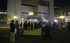 A single tent for old times sake at Dewey Square Park. The Federal Reserve of Boston is in the background.