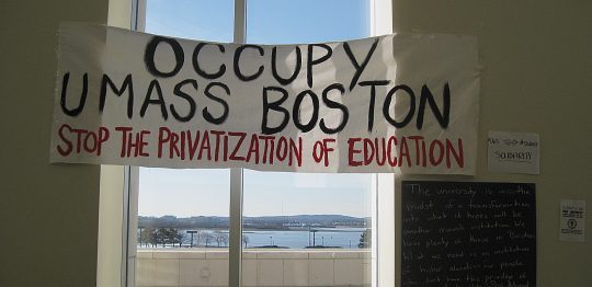 Sign and view of the harbor from level 1 of the Campus Center at UMASS Boston 1/28/12