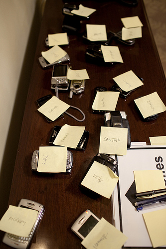 Members of Congress leave phones outside a White House meeting