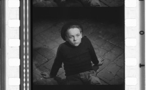 OIDCHE SHEANCHAUS boy on floor one frame with perfs