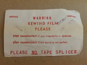 A notice requesting borrowers to rewind film.