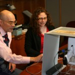 Christopher Sokolowski and Theresa Smith examine the Rabel drawing under x-ray fluorescence