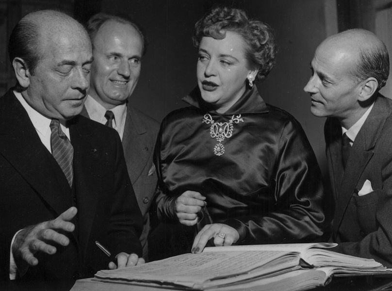 Conductor Eugene Ormandy, Tenor Set Svanholm, Eleanor Steber, and Met Manager Rudolf Bing in Vienna, [1953]. 2006MT-18