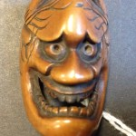 Netsuke carved as a theatrical mask. MS Thr 1040 (13)