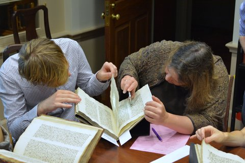 Students examine watermarks in medieval manuscripts