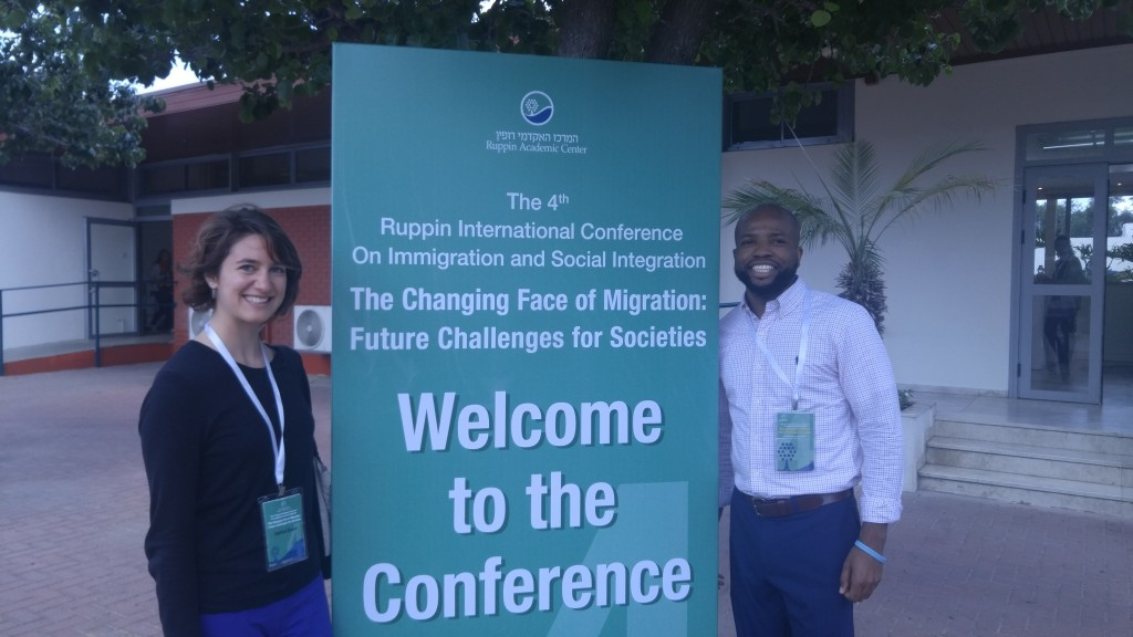 Katie and fellow intern at an international migration conference