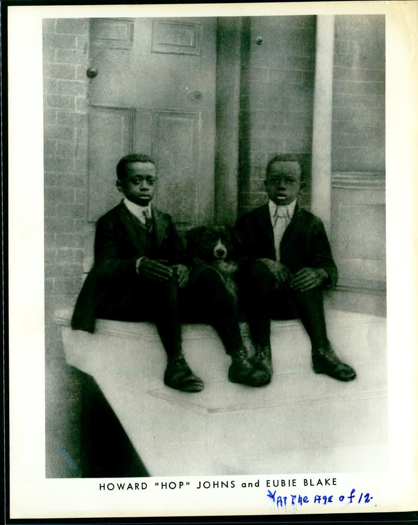 "Reproduction of photographic portrait of musician Eubie Blake and childhood friend Howard ""Hop"" Johns, 1899."