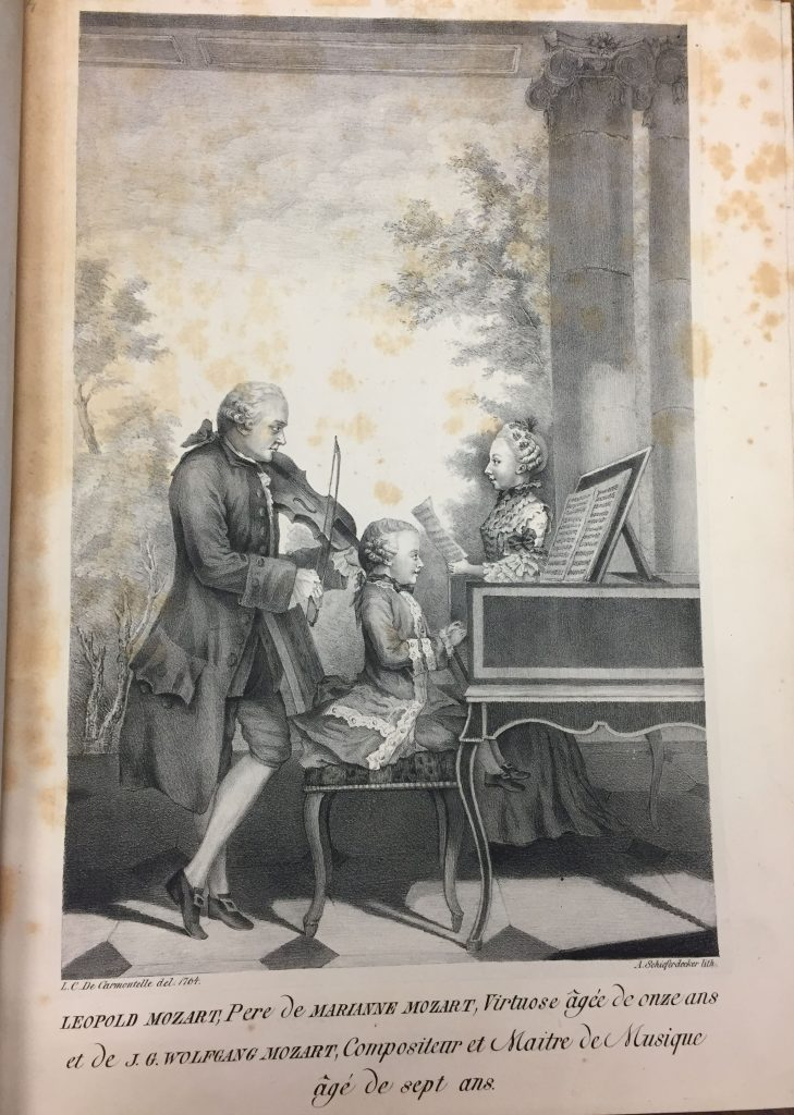Mozart family portrait, pasted to a blank page preceding the score.