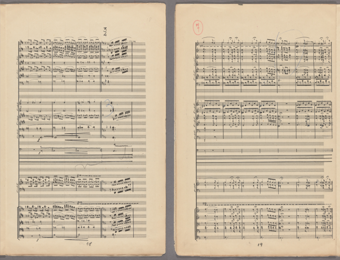 Pages 18-19 of the orchestral score of Aziz El-Shawan's opera Anās El-Wugūd, copied by the composer himself. Several lines of music spread across a tall sheets of ruled staff paper, with orchestral number 7 at the top of page 19 in red ink.