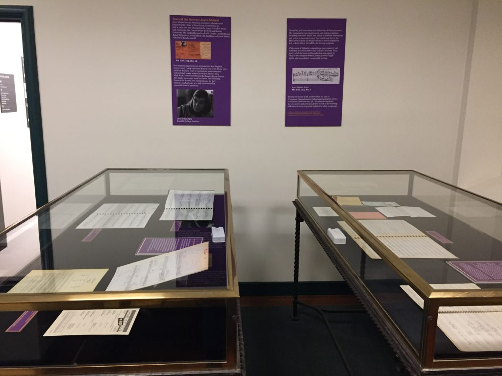 Two exhibit cases containing Mekeel materials.