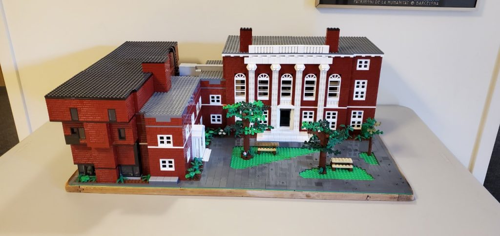 A tabletop-sized model of the Harvard music building, complete with landscaping.
