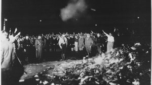 lossy-page1-1005px-thousands_of_books_smoulder_in_a_huge_bonfire_as_germans_give_the_nazi_salute_during_the_wave_of_book-burnings_that_-_nara_-_535791tif-jpg__800x450_q85_crop_upscale